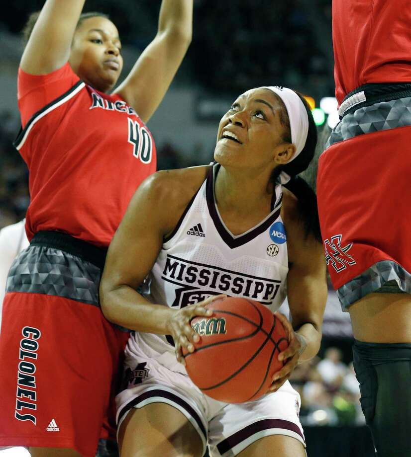 Mississippi State guard Victoria Vivians, center, looks for an opening past Nicholls players to attempt a layup during the second half of a first-round game in the NCAA women's college basketball tournament in Starkville, Miss., Saturday, March 17, 2018. Mississippi State won 95-50. (AP Photo/Rogelio V. Solis) Photo: Rogelio V. Solis / Copyright 2018 The Associated Press. All rights reserved.