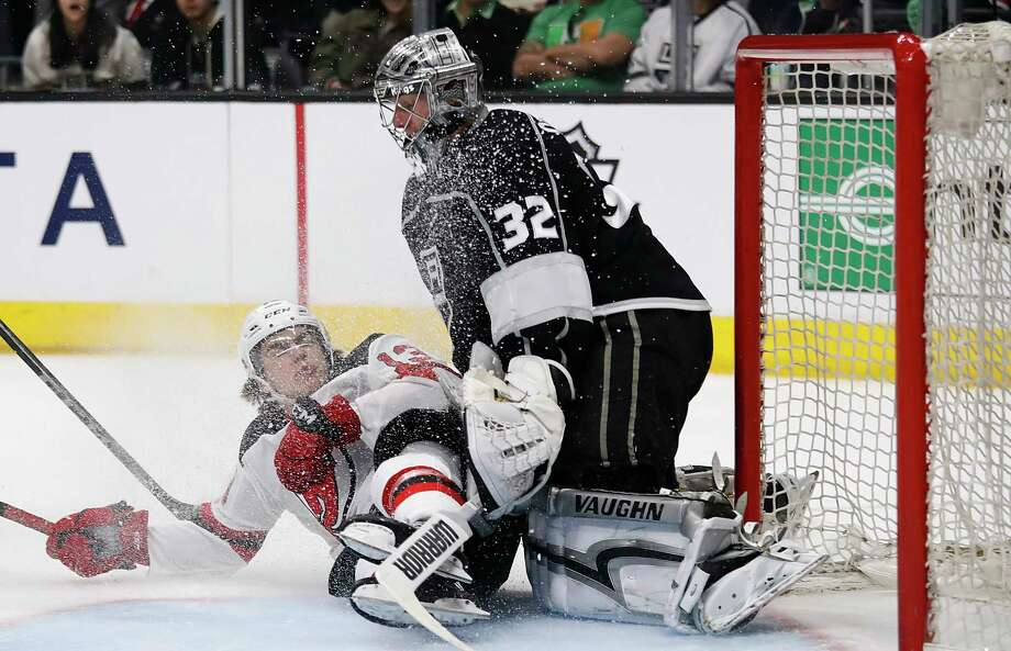 New Jersey Devils' Nico Hischier, left, of Switzerland, collides with Los Angeles Kings goaltender Jonathan Quick during the third period of an NHL hockey game Saturday, March 17, 2018, in Los Angeles. (AP Photo/Jae C. Hong) Photo: Jae C. Hong / Copyright 2018 The Associated Press. All rights reserved.