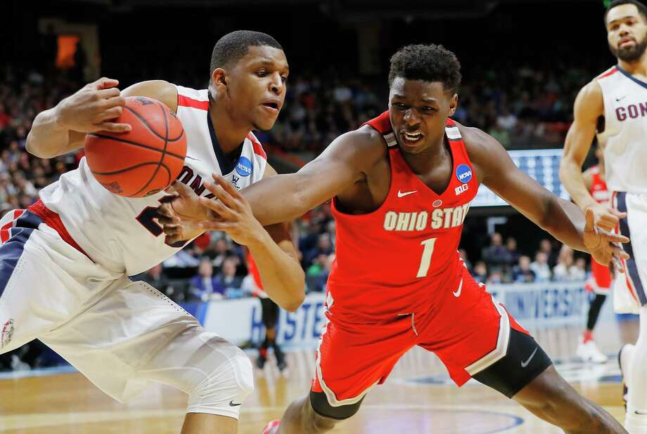BOISE, ID - MARCH 17:  Jae'Sean Tate #1 of the Ohio State Buckeyes battles for the ball with Zach Norvell Jr. #23 of the Gonzaga Bulldogs during the second half in the second round of the 2018 NCAA Men's Basketball Tournament at Taco Bell Arena on March 17, 2018 in Boise, Idaho.  (Photo by Kevin C. Cox/Getty Images) Photo: Kevin C. Cox, Staff / 2018 Getty Images