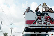 A large crowd celebrates as a parade honoring the Port Arthur Memorial basketball team's 5A state championship makes its way down Twin City Highway to Memorial Stadium Saturday. Photo taken Saturday, March 17, 2018 Kim Brent/The Enterprise