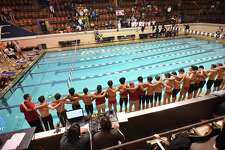 Greenwich swimmers and coaches get ready to jump in the pool to celebrate their win at the CIAC state open boys swimming championship, March 17, 2018, at Kiputh Pool at Yale University in New Haven. Greenwich won with a total of 487.5 points, finishing second, Fairfield Prep with 457 points.