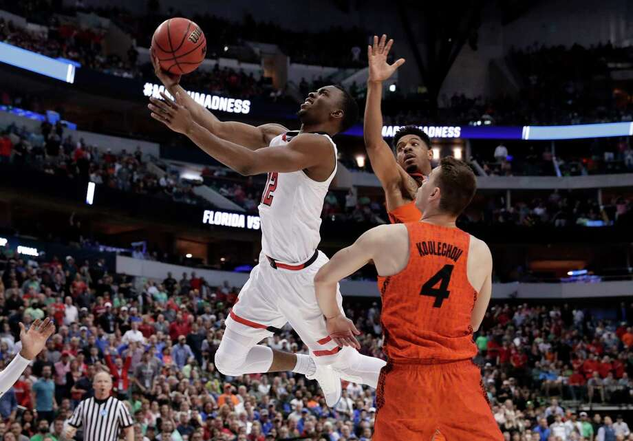 Texas Tech guard Keenan Evans (12) shoots after driving between Florida's Jalen Hudson, rear, and Egor Koulechov (4) during the second half of a second-round game at the NCAA men's college basketball tournament in Dallas, Saturday, March 17, 2018. (AP Photo/Tony Gutierrez) Photo: Tony Gutierrez, Associated Press / Copyright 2018 The Associated Press. All rights reserved.