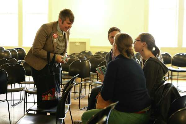 San Francisco mayoral candidate Amy Farah Weiss (left) speaks with a group of attendees after a housing town hall at the Kelly Cullen Community in San Francisco.