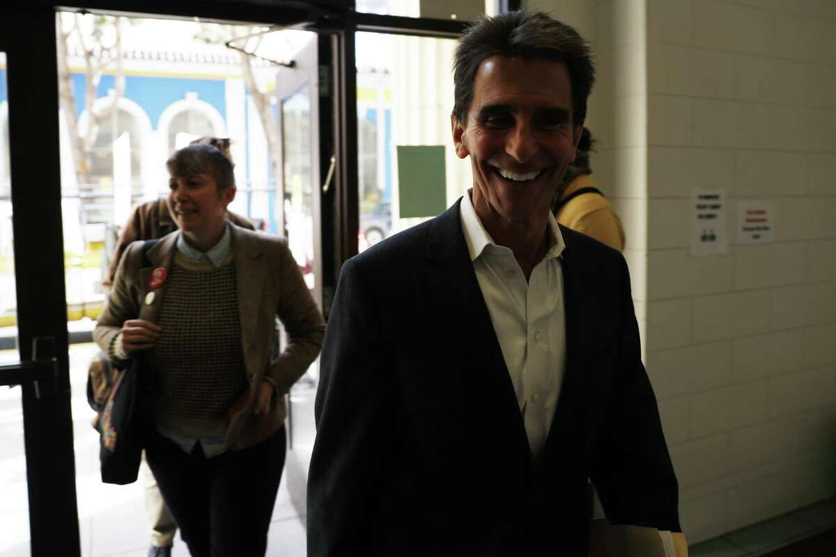 San Francisco mayoral candidate and former California State Sen. Mark Leno smiles as he and fellow candidate Amy Farah Weiss arrive for a housing town hall at the Kelly Cullen Community in San Francisco.