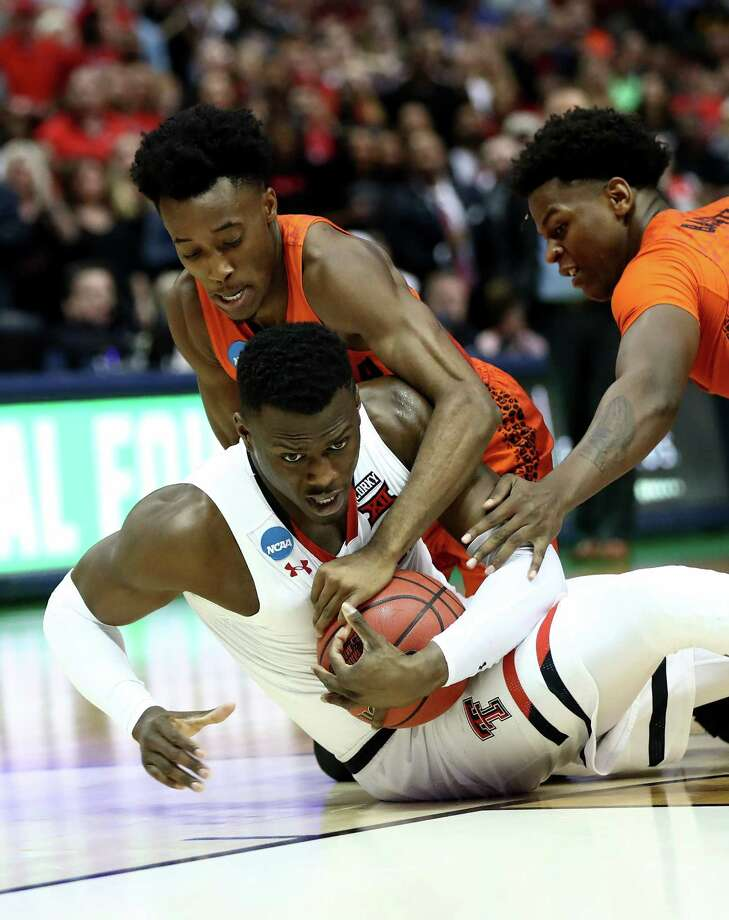 DALLAS, TX - MARCH 17:  Norense Odiase #32 of the Texas Tech Red Raiders battles for a loose ball against Mike Okauru #0 and Dontay Bassett #21 of the Florida Gators in the second half during the second round of the 2018 NCAA Tournament at the American Airlines Center on March 17, 2018 in Dallas, Texas.  (Photo by Ronald Martinez/Getty Images) Photo: Ronald Martinez / 2018 Getty Images