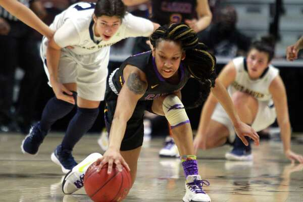 Career Magnet's Ciara Little chases down a loose ball during Class M Girls Basketball Championship action against East Haven at Mohegan Sun Arena in Montville, Conn., on Saturday Mar. 17, 2018.