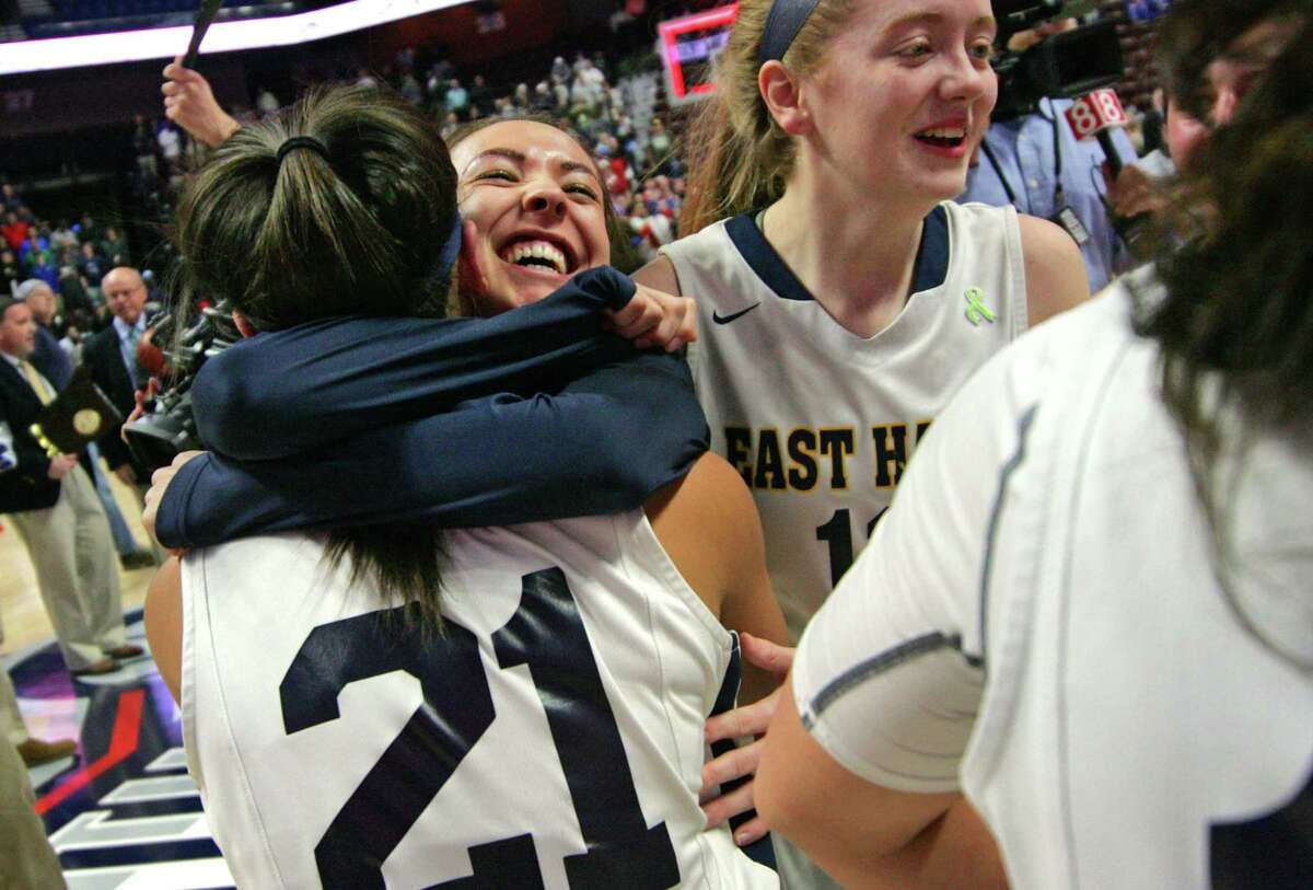 East Haven celebrates its win over Career Magnet in Class M Girls Basketball Championship action at Mohegan Sun Arena in Montville, Conn., on Saturday Mar. 17, 2018.