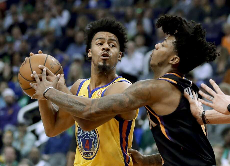 Golden State Warriors guard Quinn Cook looks to shoot past Phoenix Suns guard Elfrid Payton during the first half of an NBA basketball game in Phoenix, Saturday, March 17, 2018. (AP Photo/Chris Carlson) Photo: Chris Carlson, Associated Press