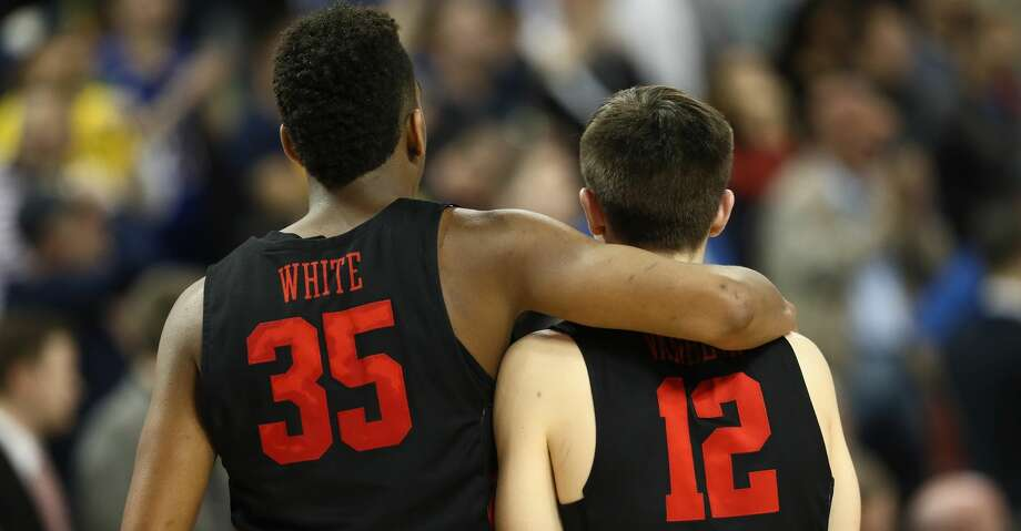 WICHITA, KS - MARCH 17:  Fabian White Jr. #35 and Wes VanBeck #12 of the Houston Cougars walk off after their 63-64 loss to the Michigan Wolverines in the second half during the second round of the 2018 NCAA Men's Basketball Tournament at INTRUST Bank Arena on March 17, 2018 in Wichita, Kansas.  (Photo by Jamie Squire/Getty Images) Photo: Jamie Squire/Getty Images