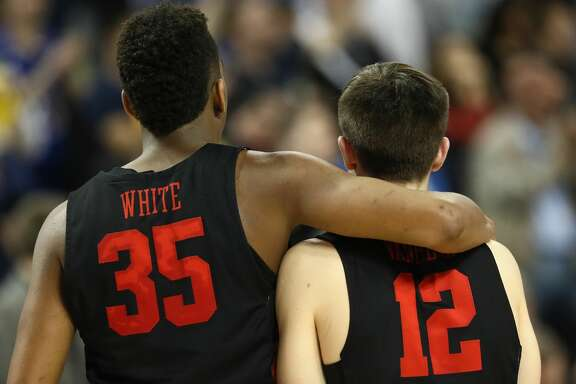 WICHITA, KS - MARCH 17:  Fabian White Jr. #35 and Wes VanBeck #12 of the Houston Cougars walk off after their 63-64 loss to the Michigan Wolverines in the second half during the second round of the 2018 NCAA Men's Basketball Tournament at INTRUST Bank Arena on March 17, 2018 in Wichita, Kansas.  (Photo by Jamie Squire/Getty Images)