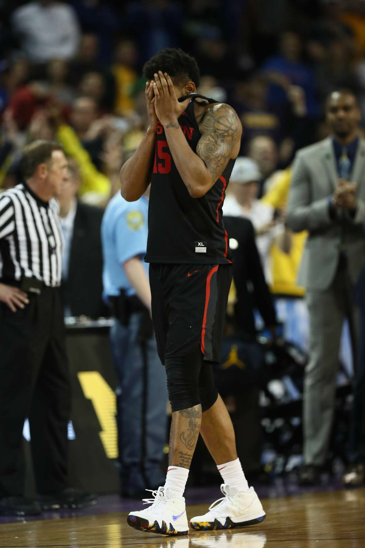 WICHITA, KS - MARCH 17: Devin Davis #15 of the Houston Cougars reacts to their 63-64 loss to the Michigan Wolverines in the second half during the second round of the 2018 NCAA Men's Basketball Tournament at INTRUST Bank Arena on March 17, 2018 in Wichita, Kansas. (Photo by Jamie Squire/Getty Images)