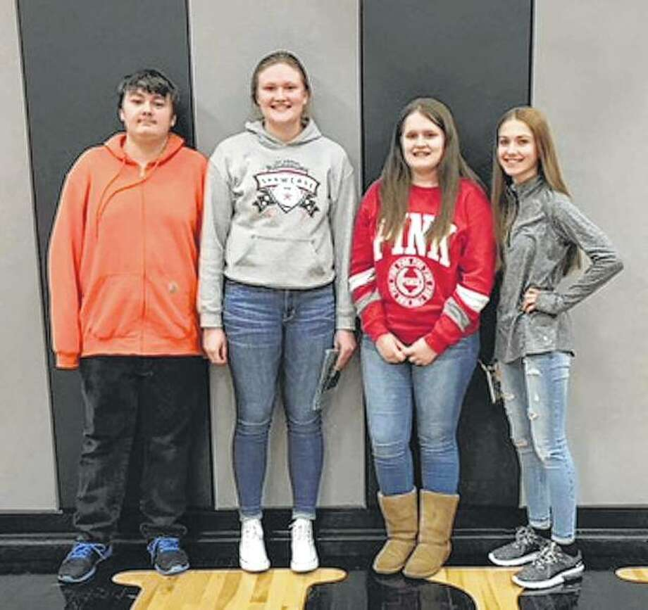 Bluffs FFA members attended a March 6 poultry competition at Bluffs High School. The Greenhand team placed first out of five teams. On the Greenhand team, Joseph Coats (from left) placed sixth individually, Morgan Hoots placed second individually, Madison Hopkins placed ninth individually and Alexis Bruns placed fifth individually. Photo: Photo Provided