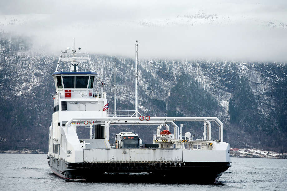 The MF Ampere, a zero-emissions ferry, sails between the villages of Oppedal and Lavik along the Sognefjord near Bergen, Norway on Feb. 21, 2018. Photo: Bloomberg Photo By Carina Johansen. / © 2018 Bloomberg Finance LP