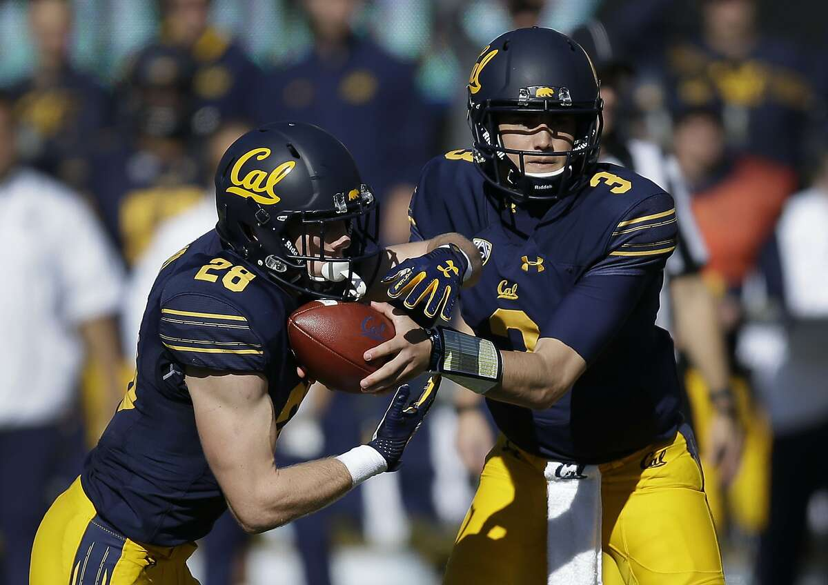 California quarterback Ross Bowers, right, hands the ball off to Patrick Laird (28) during the first half of an NCAA college football game against Oregon State on Saturday, Nov. 4, 2017, in Berkeley, Calif. (AP Photo/Ben Margot)