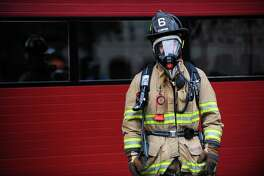 File photo of Fire fighter Jon Lund, wearing the Air-Pak X3 breathing apparatus at the Stamford Fire Department Headquarters on Main Street in Stamford, Conn. on Tuesday, Nov. 14, 2017.