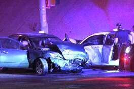 San Antonio firefighters were able to rescue a driver from their vehicle after a wreck that San Antonio police say was caused when another motorist attempted to run a red light at the intersection of Interstate 35 and Thousand Oaks Drive Saturday night, March 17, 2018.