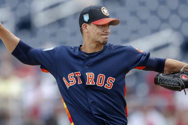 Houston Astros starting pitcher Charlie Morton (50) works in the first inning of a spring training baseball game against the Washington Nationals Tuesday, March 6, 2018, in West Palm Beach, Fla. (AP Photo/John Bazemore)