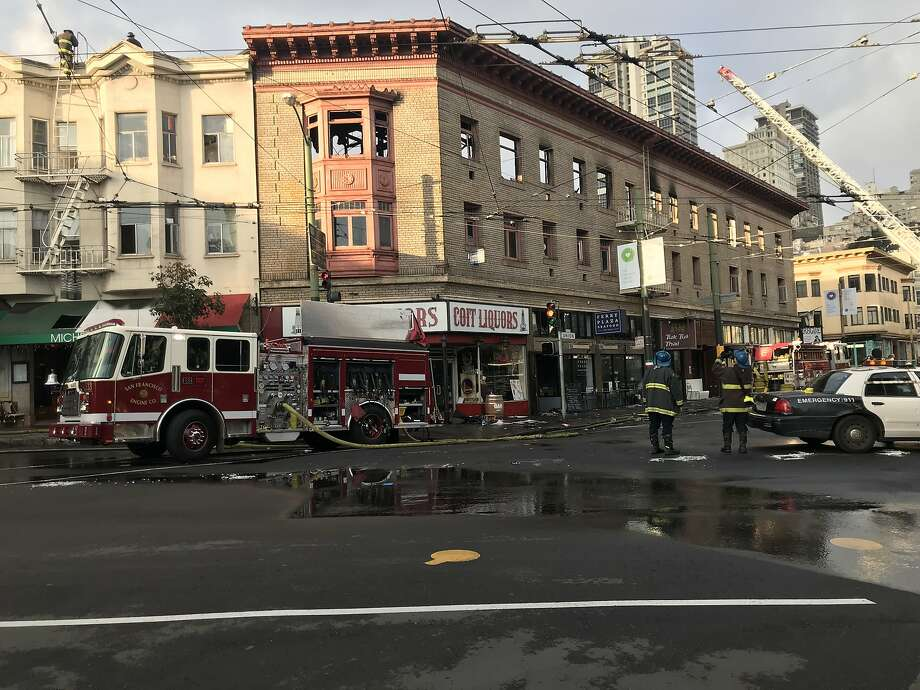 Firefighters were hosing debris from the streets and checking for flare-ups early Sunday, after massive fireripped through a three-story North Beach building on Saturday night, Photo: Sophie Haigney / The San Francisco Chronicle