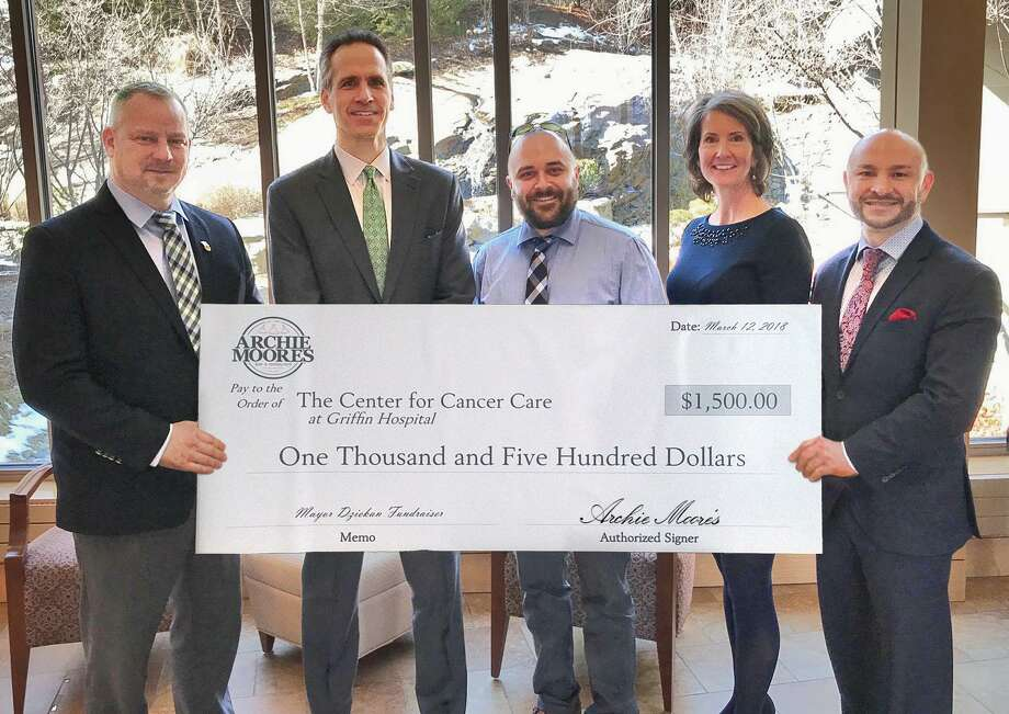 Derby Mayor Richard Dziekan, far left, and Eric Heinig, manager of Archie Moore's in Derby, center, recently presented Griffin Hospital CEO and President Patrick Charmel, second from left, with a $1,500 donation for The Center for Cancer Care at Griffin Hospital. Also pictured are Griffin Hospital Development Fund Director Tricia O'Malley and the Mayor's Chief of Staff Andrew Baklik. Photo: Contributed / Courtesy Of Griffin Hospital