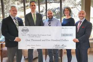 Derby Mayor Richard Dziekan, far left, and Eric Heinig, manager of Archie Moore's in Derby, center, recently presented Griffin Hospital CEO and President Patrick Charmel, second from left, with a $1,500 donation for The Center for Cancer Care at Griffin Hospital. Also pictured are Griffin Hospital Development Fund Director Tricia O'Malley and the Mayor's Chief of Staff Andrew Baklik.