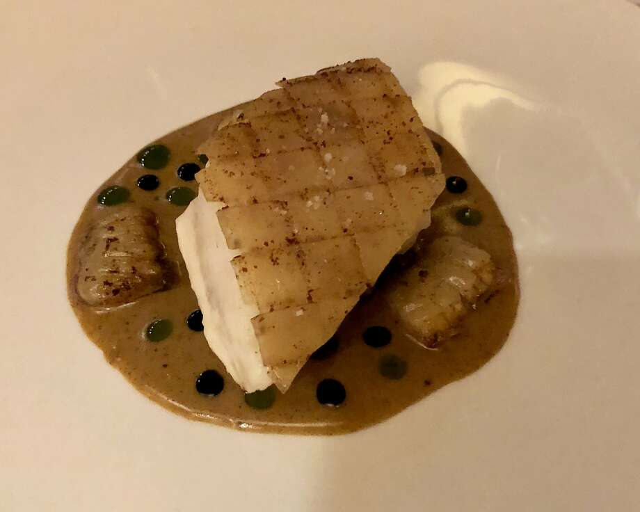 Turbot with woven potato crust, brown butter, olives and clams at Acquerello. Photo: Michael Bauer, The Chronicle