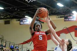 Queen Egbo (5) of Travis pulls down a rebound during the first half of the girls Bi-District playoff game between the Travis Tigers and the Katy Taylor Mustangs on Monday February 13, 2017 at Alief Taylor High School, Houston, TX.