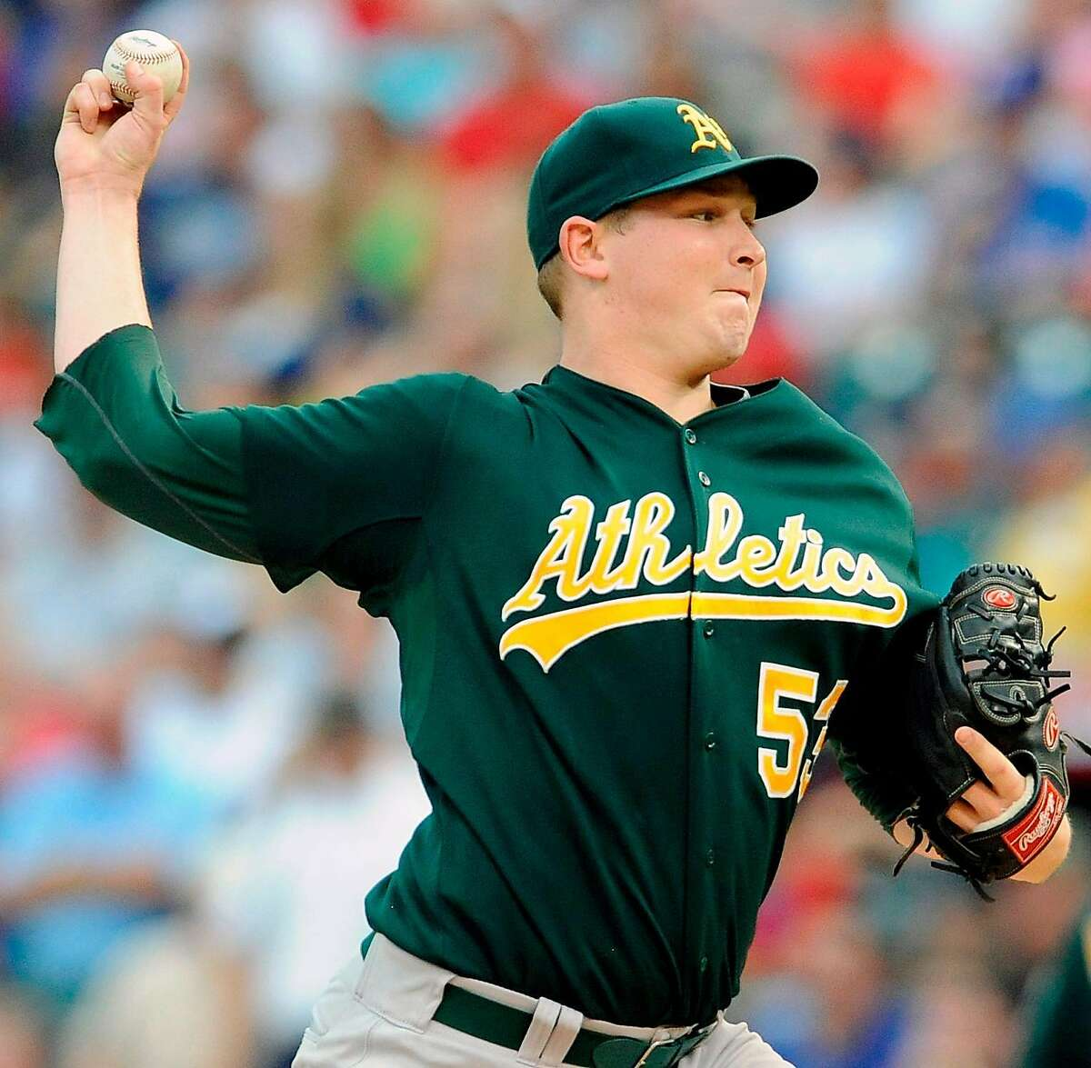 Oakland Athletic starting pitcher Trevor Cahill delivers to the Texas Rangers in the first inning of a baseball game Wednesday, July 28, 2010, in Arlington, Texas. (AP Photo/Cody Duty)