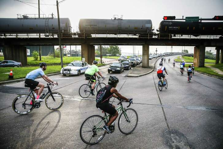 Cyclists head over Brays Bayou on Broadway Street during Tour de Houston presented by Apache Corporation Sunday, March 18, 2018 in Houston. The 60-, 40- or 20-mile fundraising bike ride benefits Houston's Reforestation Program.