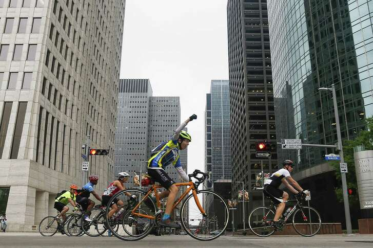 Cyclists head down Smith Street during the start of Tour de Houston presented by Apache Corporation Sunday, March 18, 2018 in Houston. The 60-, 40- or 20-mile fundraising bike ride benefits Houston's Reforestation Program.