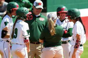 The Woodlands head coach Tim Borths talks with players and first base coach Paula Miller during the fourth inning of a non-district high school softball game at The Woodlands High School, Wednesday, March 14, 2018, in The Woodlands.