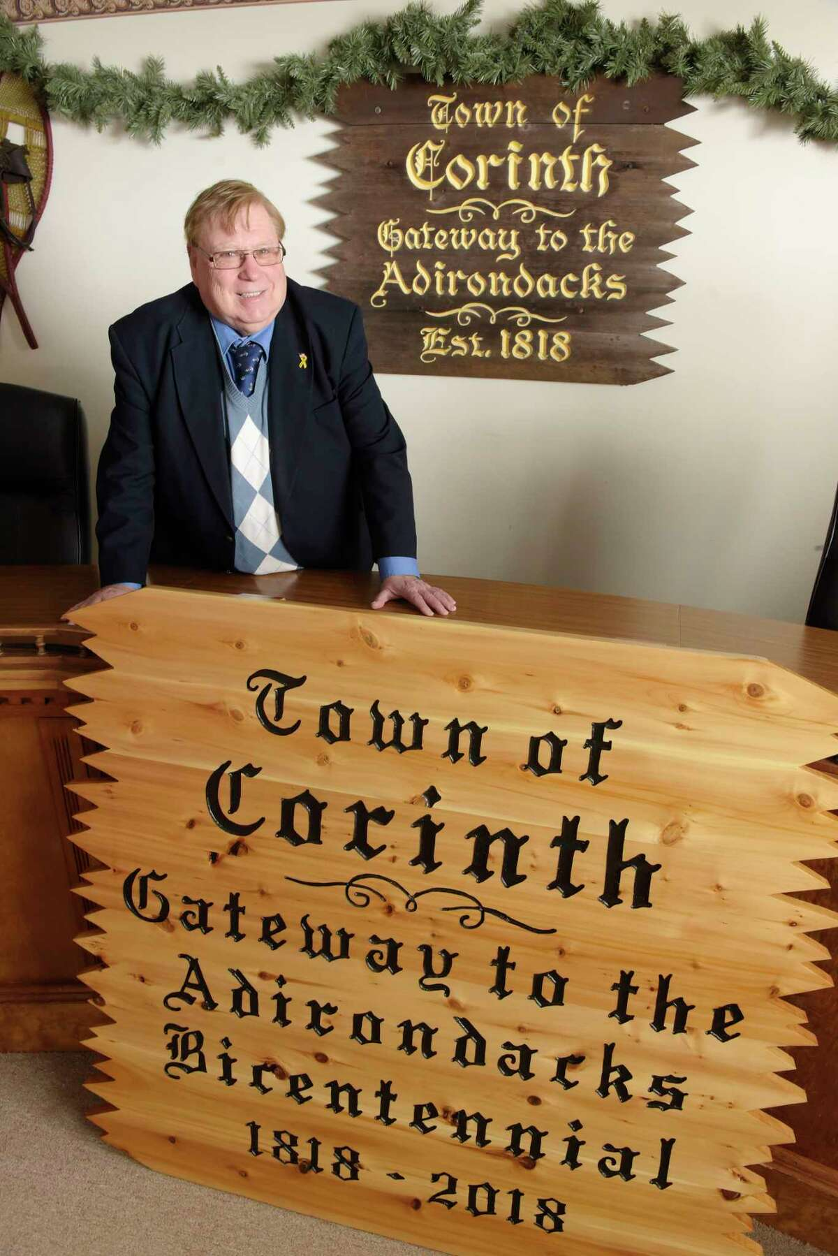 Corinth Town Supervisor Richard Lucia poses with one of the new town signs at Corinth Town Hall on Thursday, March 15, 2018, in Corinth, N.Y. Lucia is retiring after 28 years as town supervisor. (Paul Buckowski/Times Union)