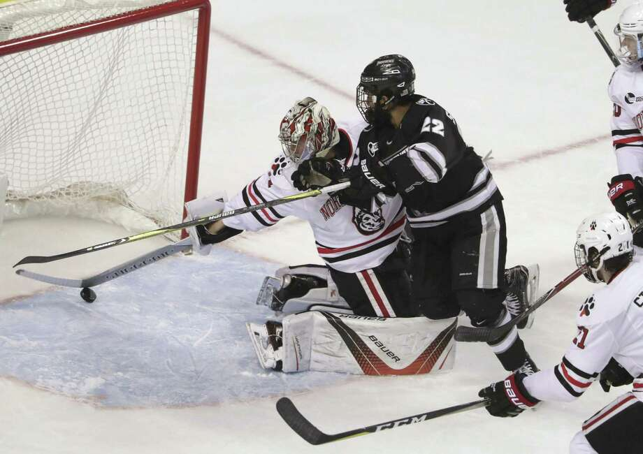 Providence forward Vimal Sukumaran (22) scores against Northeastern during the first period of a semifinal in the Hockey East tournament on Friday in Boston. Photo: Barry Chin / Associated Press / The Boston Globe