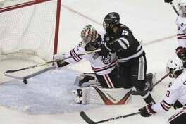 Providence forward Vimal Sukumaran (22) scores against Northeastern during the first period of a semifinal in the Hockey East tournament on Friday in Boston.