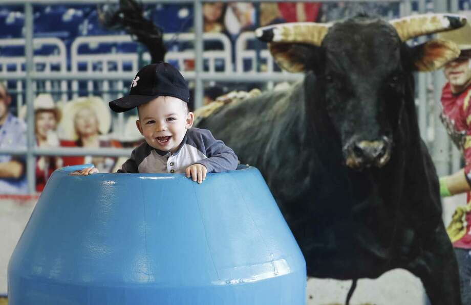 Kyle Beck, 16 months, of Houston, gets his photo taken in the bullfighter barrel at the Houston Livestock Show and Rodeo at NRG Center on March 13. Photo: Karen Warren, Staff / Houston Chronicle / © 2018 Houston Chronicle