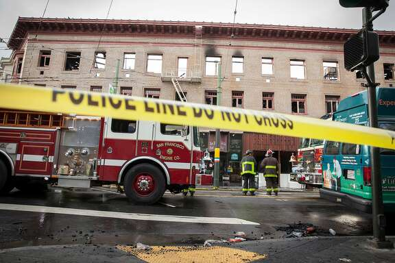 Mop-up fire crews survey the damage to the building at 659 Union Street after it burned in a 4-Alarm blaze that gutted the upper floors of the building in San Francisco, California, USA 18 Mar 2018.