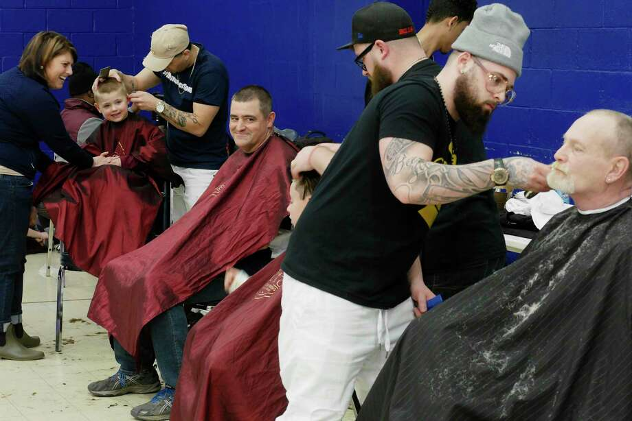 Barbers with The Palace Barber Shop in Troy volunteer their time at the Boys and Girls Club of Southern Rensselaer County during a fundraiser for the children of Brianna Beebe and also for the Alshami family, on Sunday, March 18, 2018, in Rensselaer, N.Y.  Marlon Sousis, owner of the barber shop was one of the organizers of the event.  (Paul Buckowski/Times Union) Photo: Albany Times Union / (Paul Buckowski/Times Union)