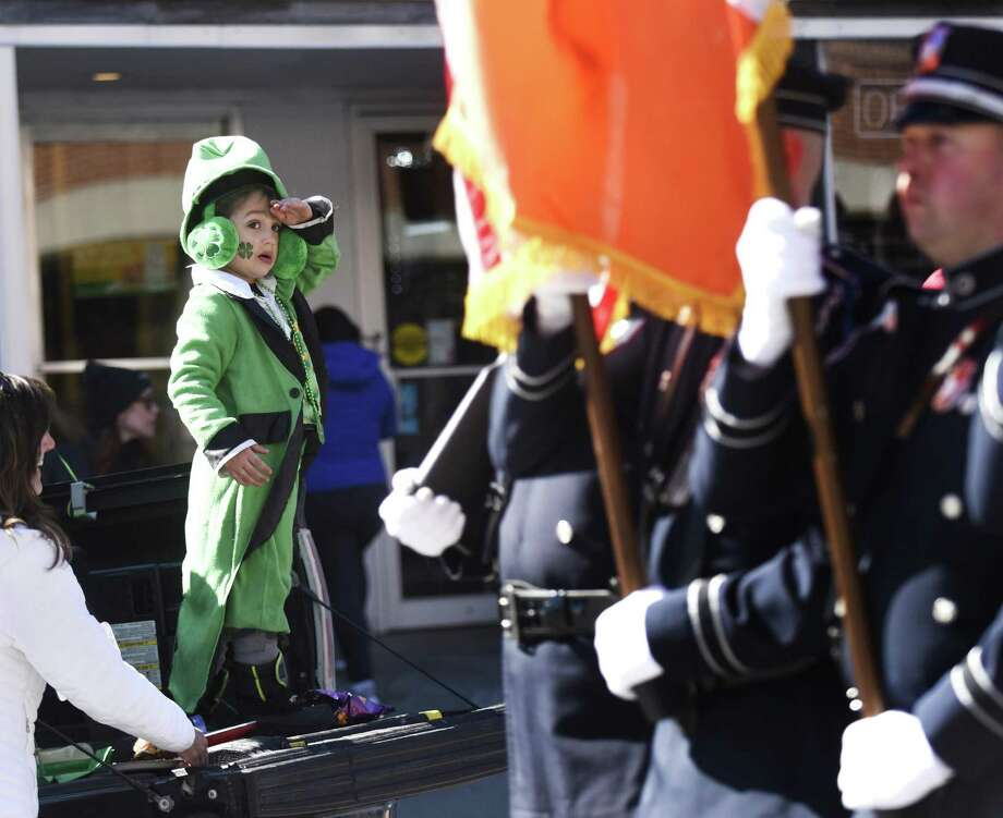 Michael Young, of Trumbull, salutes as Greenwich Police lead the Greenwich St. Patrick's Day Parade down Greenwich Avenue in Greenwich, Conn. Sunday, March 18, 2018. Presented by the Greenwich Hibernian Association, the parade featured Irish bagpipe music, Irish dancers, floats from many local organizations, as well as Greenwich police, fire and EMS. Photo: Tyler Sizemore / Hearst Connecticut Media / Greenwich Time