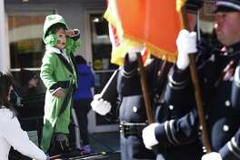 Michael Young, of Trumbull, salutes as Greenwich Police lead the Greenwich St. Patrick's Day Parade down Greenwich Avenue in Greenwich, Conn. Sunday, March 18, 2018. Presented by the Greenwich Hibernian Association, the parade featured Irish bagpipe music, Irish dancers, floats from many local organizations, as well as Greenwich police, fire and EMS.