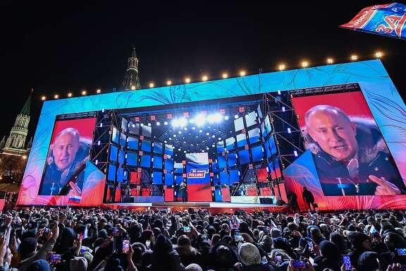 Presidential candidate, President Vladimir Putin addresses the crowd during a rally and a concert celebrating the fourth anniversary of Russia's annexation of Crimea at Manezhnaya Square in Moscow on March 18, 2018. / AFP PHOTO / Kirill KUDRYAVTSEVKIRILL KUDRYAVTSEV/AFP/Getty Images