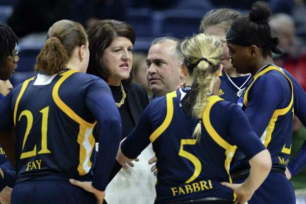 Quinnipiac head coach Tricia Fabbri confers with her team, including her daughter Carly (5) during a timeout in their NCAA tournament first-round game against Miami on Saturday.
