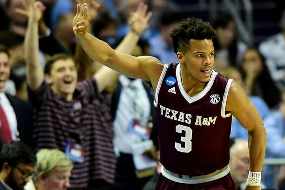 CHARLOTTE, NC - MARCH 18:  Admon Gilder #3 of the Texas A&M Aggies reacts after a three point shot against the North Carolina Tar Heels during the second round of the 2018 NCAA Men's Basketball Tournament at Spectrum Center on March 18, 2018 in Charlotte, North Carolina.  (Photo by Jared C. Tilton/Getty Images)