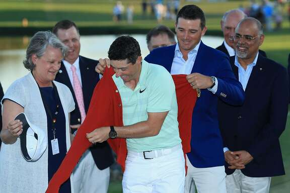 ORLANDO, FL - MARCH 18:  Rory McIlroy of Northern Ireland is given the new red Arnold Palmer sweater  during the final round at the Arnold Palmer Invitational Presented By MasterCard at Bay Hill Club and Lodge on March 18, 2018 in Orlando, Florida.  (Photo by Sam Greenwood/Getty Images)