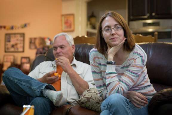 Amy Starr sits with her father, Steve Cowan, at her nephew's birthday party in Tomball, Texas on Thursday, March 8, 2018. Starr had her fallopian tubes removed after having her sons in hopes of lowering her risk of ovarian cancer. ( Loren Elliott/ For the Houston Chronicle )