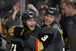 LAS VEGAS, NV - MARCH 18:  William Karlsson #71 of the Vegas Golden Knights celebrates with teammate Brayden McNabb #3 after Karlsson scored his third goal of the second period against the Calgary Flames during their game at T-Mobile Arena on March 18, 2018 in Las Vegas, Nevada.  (Photo by Ethan Miller/Getty Images)