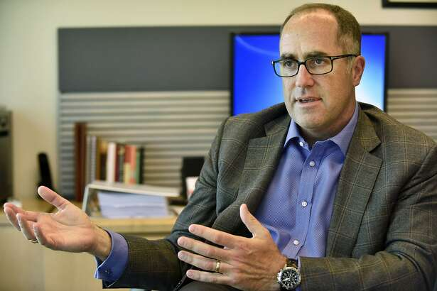 Doug Haynes, president of Point72 Asset Management, talks to reporters in the company's offices in Stamford, Conn., on Wednesday, May 20, 2015. Haynes' resignation from Point72 was announced to employees March 16, 2018 by the firm's founder, Steven Cohen.