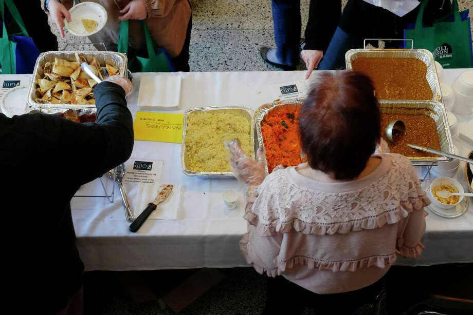 People make their way around to the different tables to try the various foods at the 15th Annual Jewish Food Festival at Congregation Gates of Heaven on Sunday, March 18, 2018, in Schenectady, N.Y. The festival is sponsored by Price Chopper/Market 32, Adirondack Oral and Maxillofacial Surgery, Catskill Hudson Bank, Hugh Johnson Advisors and Tech Valley Drywall. The yearly festival is held to raise money for Gates of Heaven programing and dues assistance for members.  (Paul Buckowski/Times Union) Photo: PAUL BUCKOWSKI / (Paul Buckowski/Times Union)
