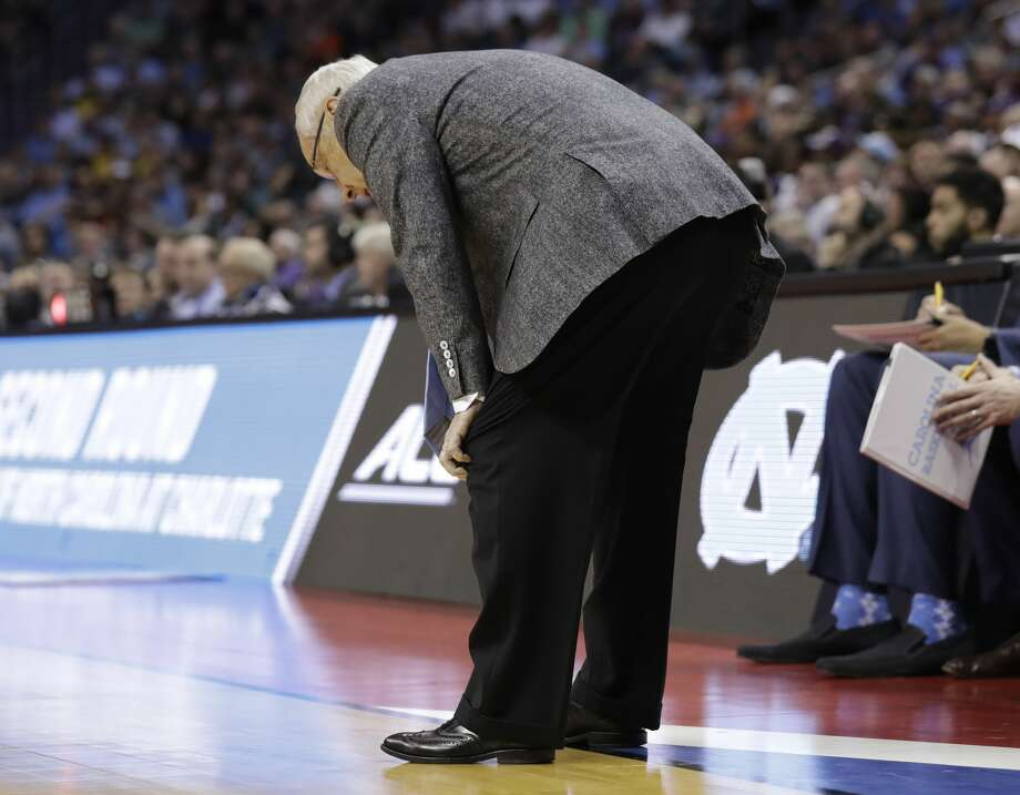 North Carolina head coach Roy Williams bends over in the final minutes during the second half of a second-round game against Texas A&M in the NCAA men's college basketball tournament in Charlotte, N.C., Sunday, March 18, 2018. (AP Photo/Gerry Broome) Photo: Gerry Broome/Associated Press