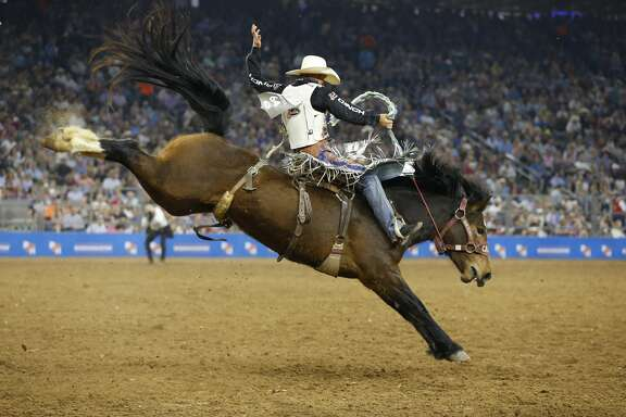 Heath Demoss performs his winning ride during RodeoHouston Super Shootout: North America's Champions action Sunday, March 18, 2018, in Houston. ( Steve Gonzales / Houston Chronicle )