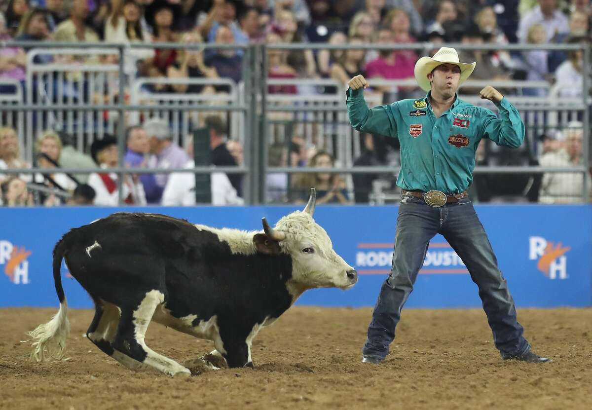 Tyler Waguespack celebrates in the Steer Wrestling event during RodeoHouston Super Shootout: North America's Champions action Sunday, March 18, 2018, in Houston. ( Steve Gonzales / Houston Chronicle )