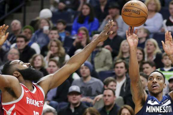 Minnesota Timberwolves guard Jeff Teague (0) shoots over Houston Rockets guard James Harden (13) in the first quarter of an NBA basketball game Sunday, March 18, 2018, in Minneapolis. (AP Photo/Andy Clayton-King)